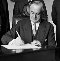 Governor Frank G. Allen signing bill to grant Bachelor of Science degrees at Northeastern University, February 6, 1930.